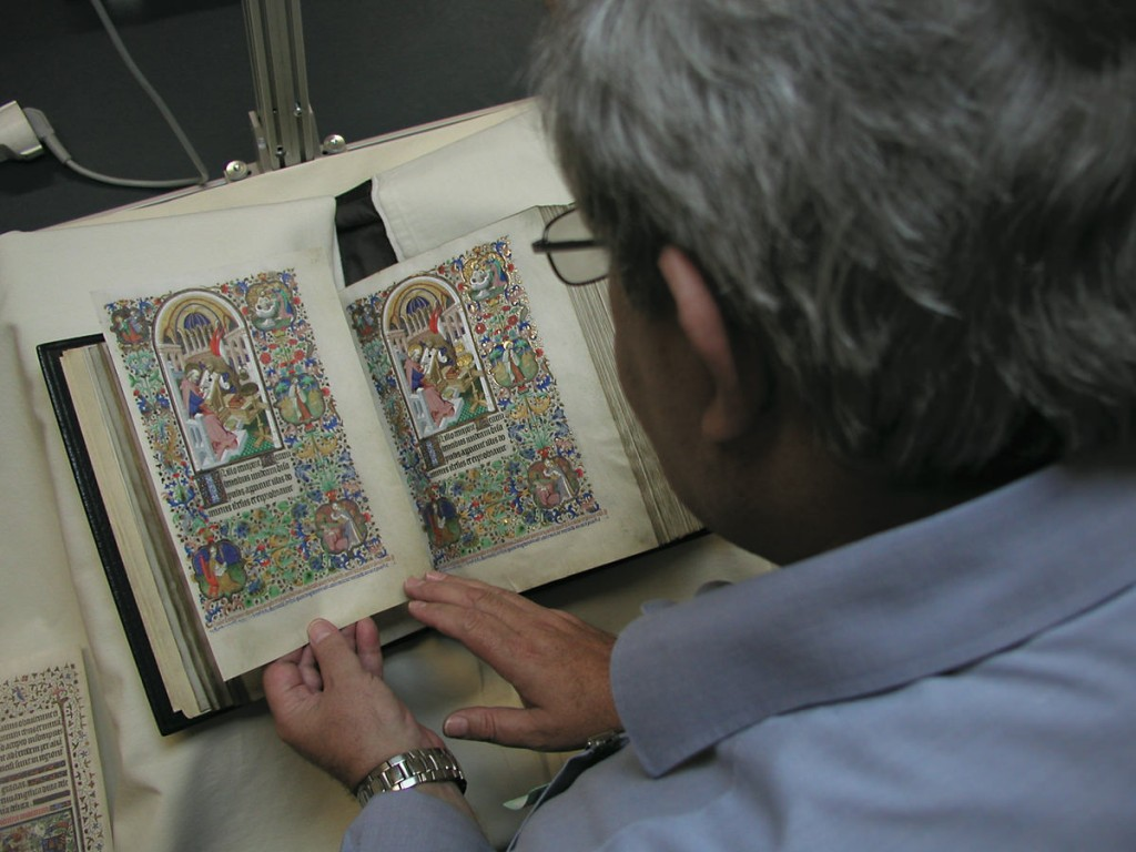 Picture showing a facsimile page compared with the original