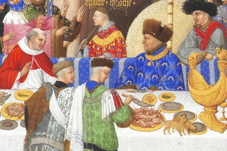 Depiction of Jean de Berry sat at the table wearing a blue garment